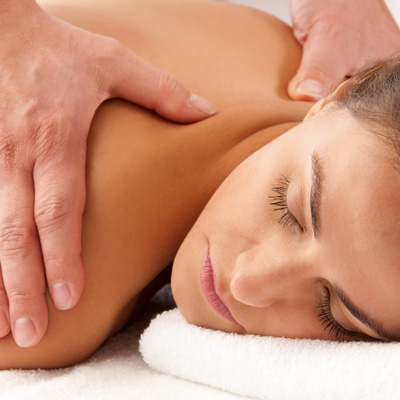 A woman receiving a back massage at AcuDenver.