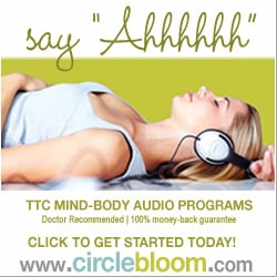 Circle Bloom say ahhhh woman laying down with headphones on.