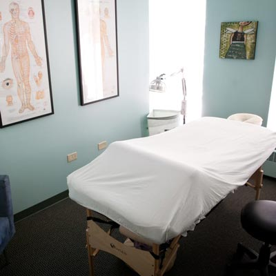 Office with a massage table prepared for fertility and pregnancy care.